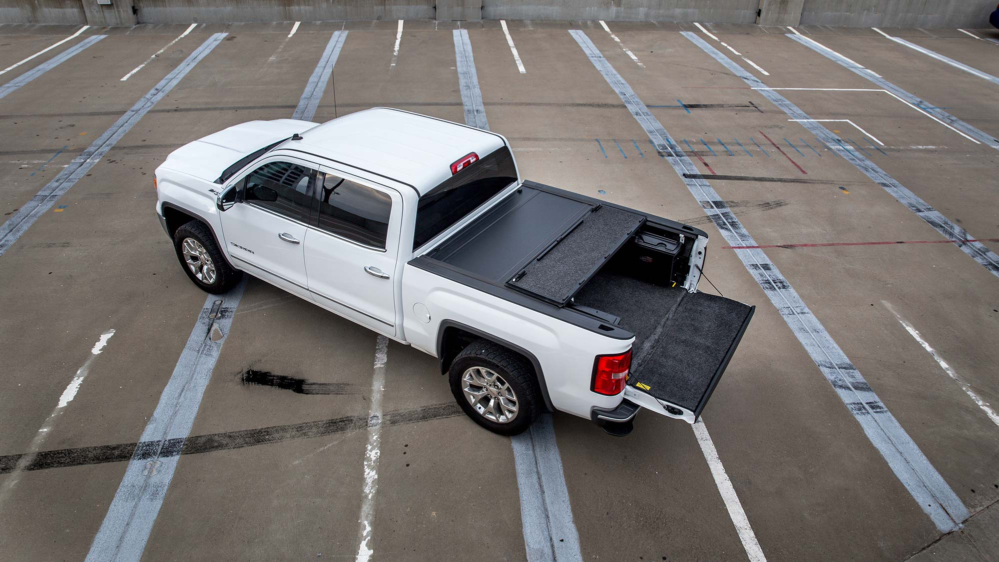 White pickup on roof parking from top