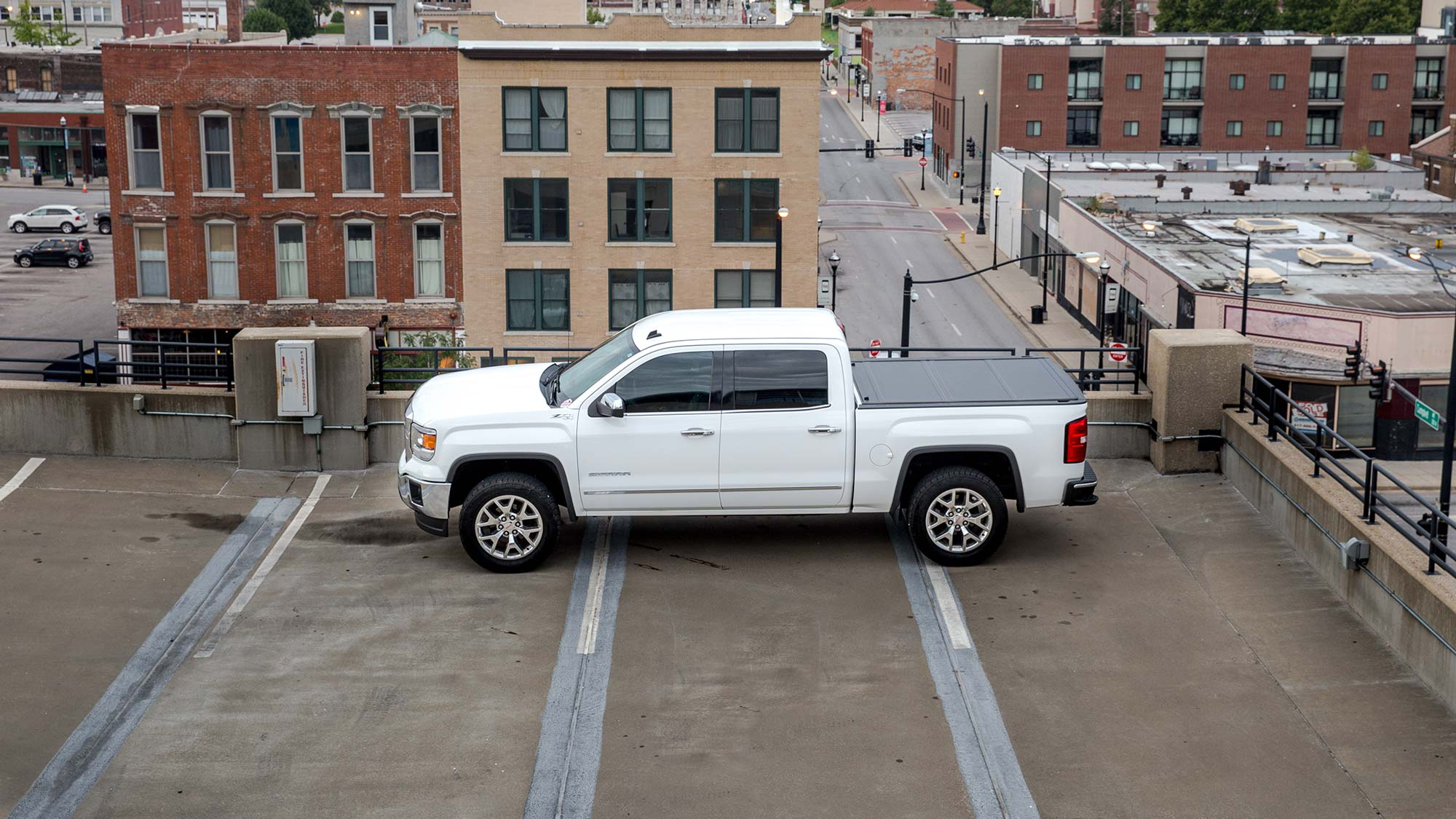 White pickup on roof parking